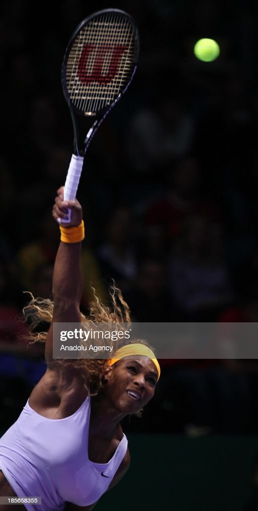 Serena Williams of the US returns the ball to Agnieszka Radwanska of Poland during their TEB BNP Paribas WTA Championships match at Sinan Erdem Dome on October 23, 2013 in Istanbul, Turkey.