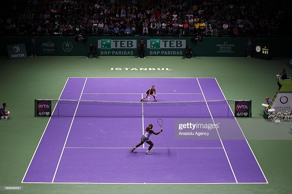 Serena Williams (front) of the US returns the ball to Agnieszka Radwanska of Poland during their TEB BNP Paribas WTA Championships match at Sinan Erdem Dome on October 23, 2013 in Istanbul, Turkey.
