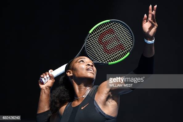 TOPSHOT Serena Williams of the US serves against Czech Republic's Barbora Strycova during their women's singles fourth round match on day eight of...