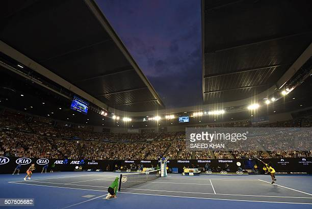 Serena Williams of the US serves during her women's singles final match against Germany's Angelique Kerber on day thirteen of the 2016 Australian...