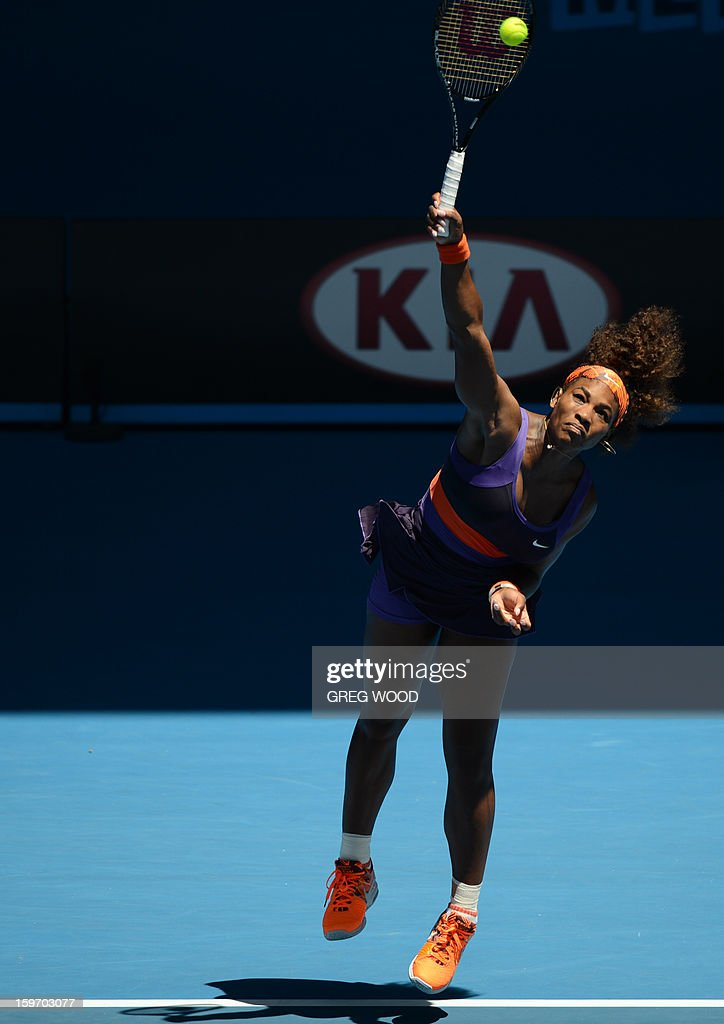 Serena Williams of the US serves during her women's singles match against Ayumi Morita of Japan on the sixth day of the Australian Open tennis tournament in Melbourne on January 19, 2013.