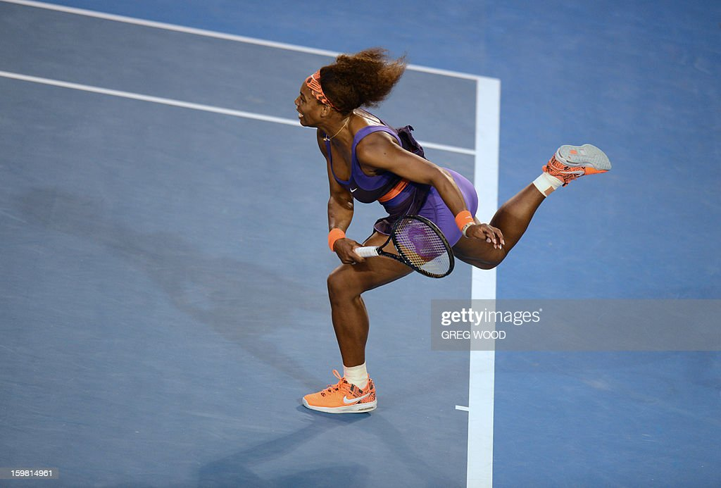 Serena Williams of the US serves during her women's singles match against Russia's Maria Kirilenko on the eighth day of the Australian Open tennis tournament in Melbourne on January 21, 2013. AFP PHOTO/ GREG WOOD IMAGE STRICTLY RESTRICTED TO EDITORIAL USE - STRICTLY NO COMMERCIAL USE