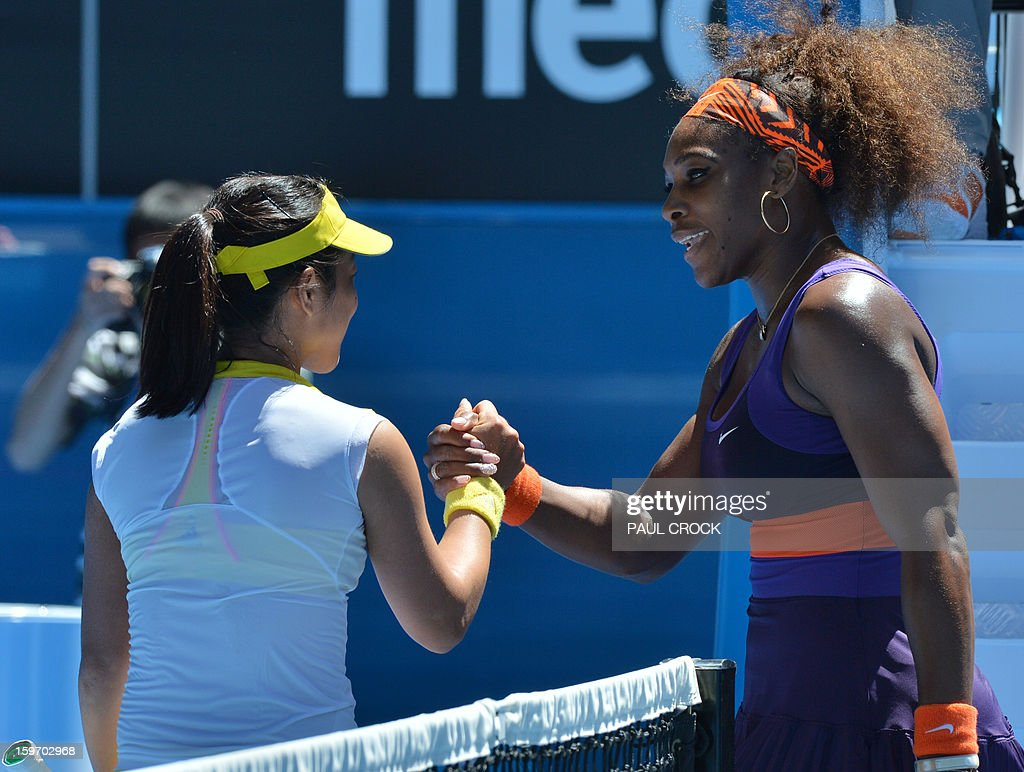 Serena Williams of the US (R) shakes hands after victory in her women's singles match against Ayumi Morita of Japan on the sixth day of the Australian Open tennis tournament in Melbourne on January 19, 2013.