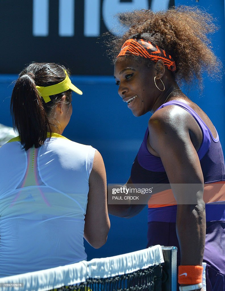 Serena Williams of the US (R) shakes hands after victory in her women's singles match against Ayumi Morita of Japan on the sixth day of the Australian Open tennis tournament in Melbourne on January 19, 2013. AFP PHOTO/PAUL CROCK IMAGE STRICTLY RESTRICTED TO EDITORIAL USE - STRICTLY NO COMMERCIAL USE