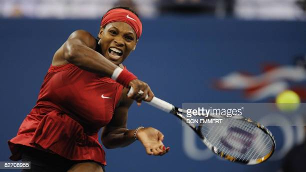 Serena Williams of the US smashes a return to Jelena Jankovic of Serbia during the women's final at the US Open tennis tournament September 7 2008 in...