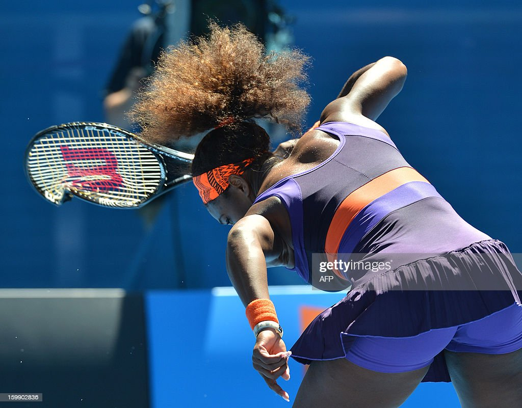 Serena Williams of the US smashes her racquet during her women's singles match against compatriot Sloane Stephens on the tenth day of the Australian Open tennis tournament in Melbourne on January 23, 2013. AFP PHOTO/PAUL CROCK IMAGE STRICTLY RESTRICTED TO EDITORIAL USE - STRICTLY NO COMMERCIAL USE
