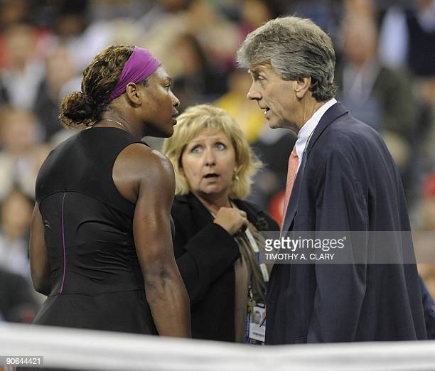 Serena Williams of the US talks to US Open head referee Brian Earley after being penalized in her match against Kim Clijsters from Belgium during...