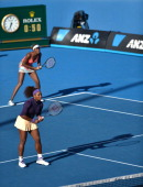 Serena Williams of the US waits with her sister Venus Williams to receive service during their women's doubles match against Vera Dushevina of Russia...
