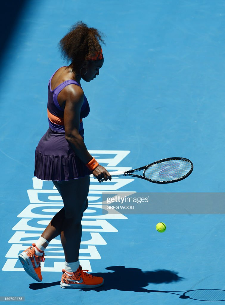 Serena Williams of the US walks on court during her women's singles match against Ayumi Morita of Japan on the sixth day of the Australian Open tennis tournament in Melbourne on January 19, 2013.