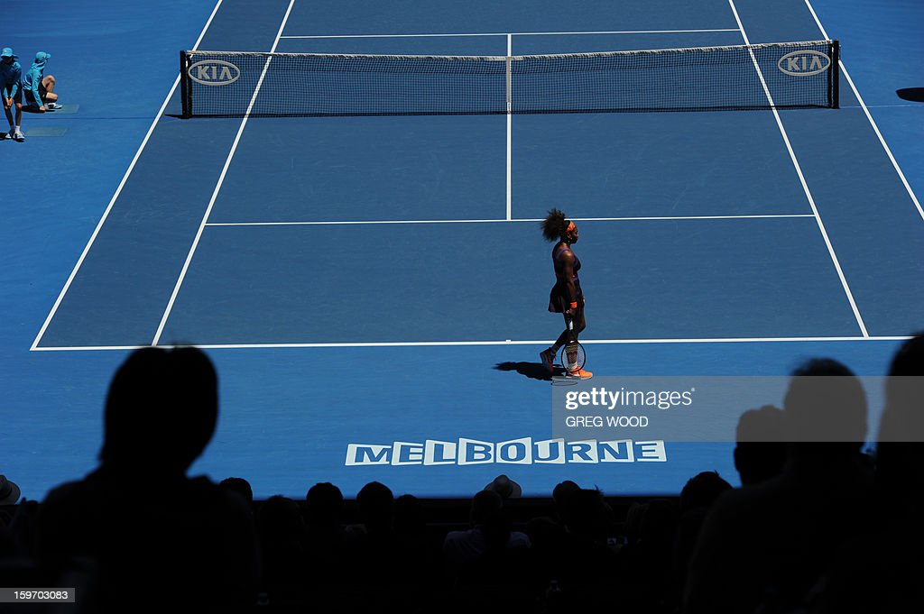 Serena Williams of the US walks on court during her women's singles match against Ayumi Morita of Japan on the sixth day of the Australian Open tennis tournament in Melbourne on January 19, 2013. AFP PHOTO/ GREG WOOD IMAGE STRICTLY RESTRICTED TO EDITORIAL USE - STRICTLY NO COMMERCIAL USE