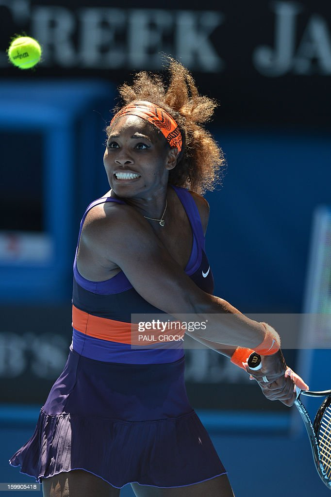 Serena Williams of the US watches the ball as she plays a return during her women's singles match against compatriot Sloane Stephens on the tenth day of the Australian Open tennis tournament in Melbourne on January 23, 2013.