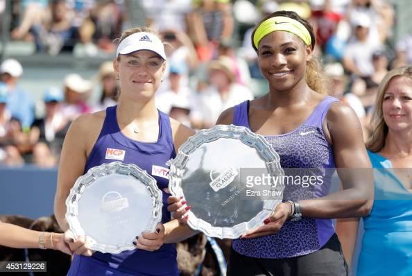Serena Williams of the USA and Angelique Kerber of Germany hold up their trophies after Williams won the finals of the Bank of the West Classic at...
