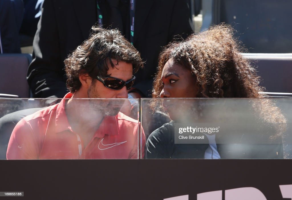 Serena Williams of the USA and her coach Patrick Mourataglou watch her sister Venus Williams of the USA play against Laura Robson of Great Britain in their first round match during day two of the Internazionali BNL d'Italia 2013 at the Foro Italico Tennis Centre on May 13, 2013 in Rome, Italy.