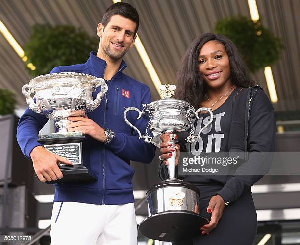 Serena Williams of the USA and Novak Djokovic of Serbia pose with the trophies during the 2016 Australian Open official draw at Melbourne Park on...