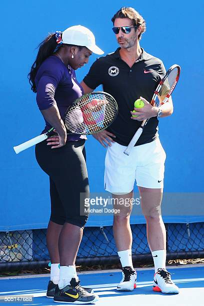 Serena Williams of the USA appears to be in discomfort next to coach Patrick Mouratoglou and leaves the court moments later during a practice session...