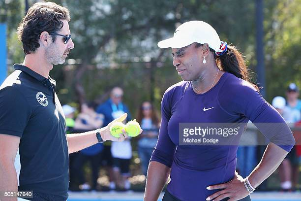 Serena Williams of the USA appears to grimace in discomfort next to coach Patrick Mouratoglou and leaves the court moments later during a practice...