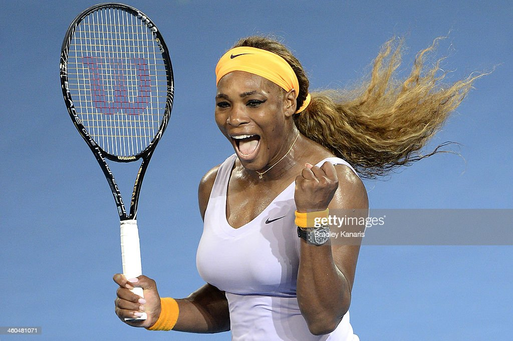 Serena Williams of the USA celebrates victory after winning her finals match against Victoria Azarenka of Belarus during day seven of the 2014 Brisbane International at Queensland Tennis Centre on January 4, 2014 in Brisbane, Australia.