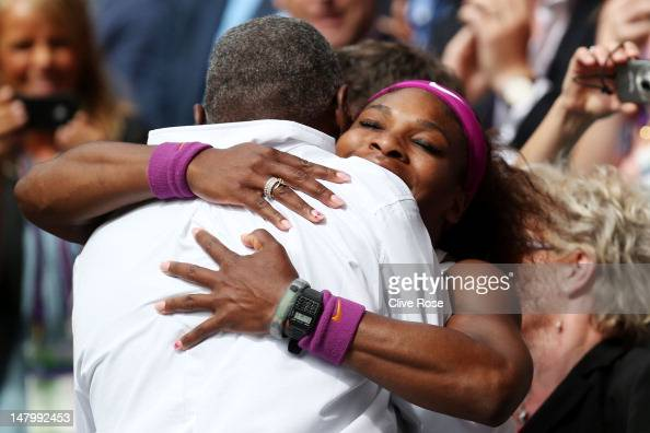 Serena Williams of the USA celebrates with her father Richard Williams after her Ladies' Singles final match against Agnieszka Radwanska of Poland on...