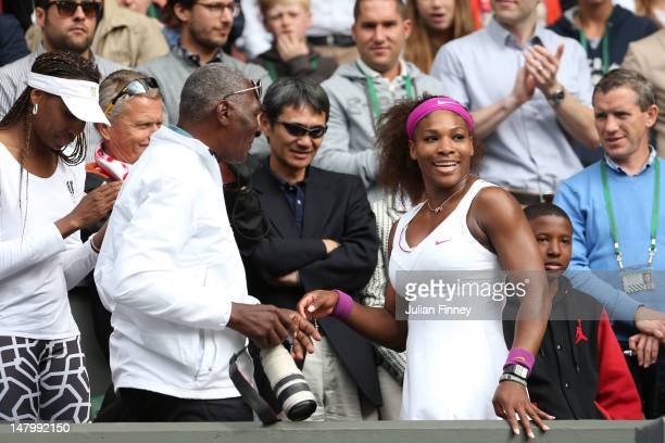 Serena Williams of the USA celebrates with her father Richard Williams and sister Venus Williams after her Ladies' Singles final match against...