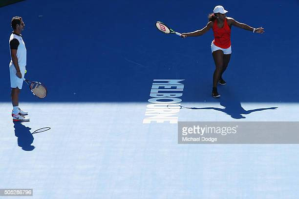 Serena Williams of the USA hits a forehand next to coach Patrick Mouratoglouduring a practice session ahead of the 2016 Australian Open at Melbourne...