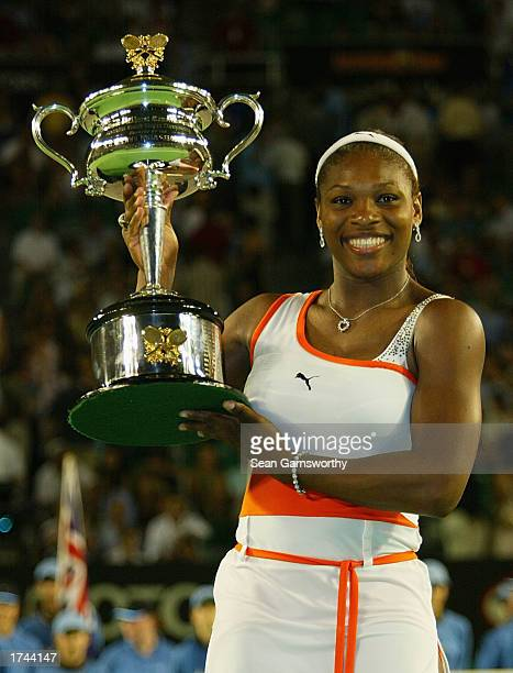Serena Williams of the USA holds the winners trophy during the Women's Singles final during the Australian Open Tennis Championships at Melbourne...