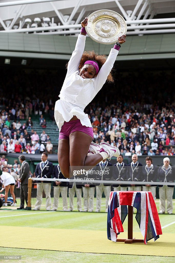 <a gi-track='captionPersonalityLinkClicked' href=/galleries/search?phrase=Serena+Williams&family=editorial&specificpeople=171101 ng-click='$event.stopPropagation()'>Serena Williams</a> of the USA jumps in the air with the winners trophy and celebrates after her Ladies' Singles final match against Agnieszka Radwanska of Poland on day twelve of the Wimbledon Lawn Tennis Championships at the All England Lawn Tennis and Croquet Club on July 7, 2012 in London, England.
