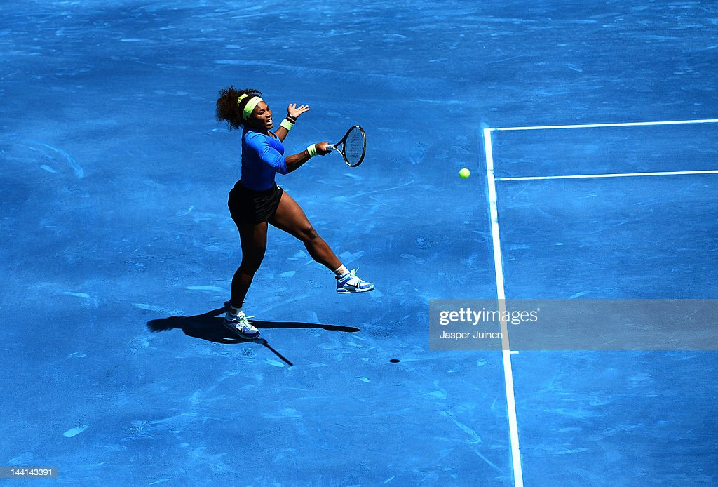 Serena Williams of the USA plays a backhand to Caroline Wozniacki of Denmark during the Mutua Madrilena Madrid Open tennis tournament at the Caja Magica on May 10, 2012 in Madrid, Spain.