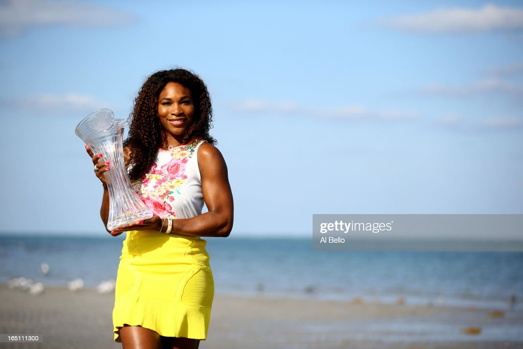 Serena Williams of the USA poses with the winners trophy at Crandon Park beach after defeating Maria Sharapova of Russia after the Womens Final match of the Sony Open on Day 13 at Crandon Park Tennis Center on March 30, 2013 in Key Biscayne, Florida.
