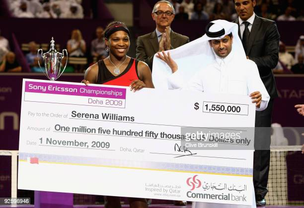 Serena Williams of the USA receives the winners cheque from Nasser Al KhulaifiPresident of the Qatar Tennis Federation after her straight sets...