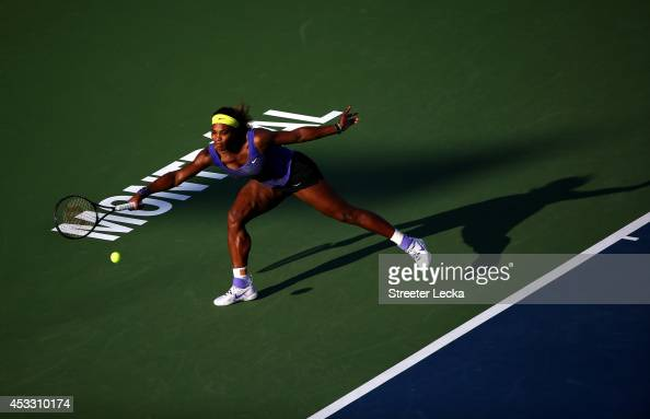 Serena Williams of the USA returns a shot to Lucie Safarova of the Czech Republic during the Rogers Cup at Uniprix Stadium on August 7 2014 in...