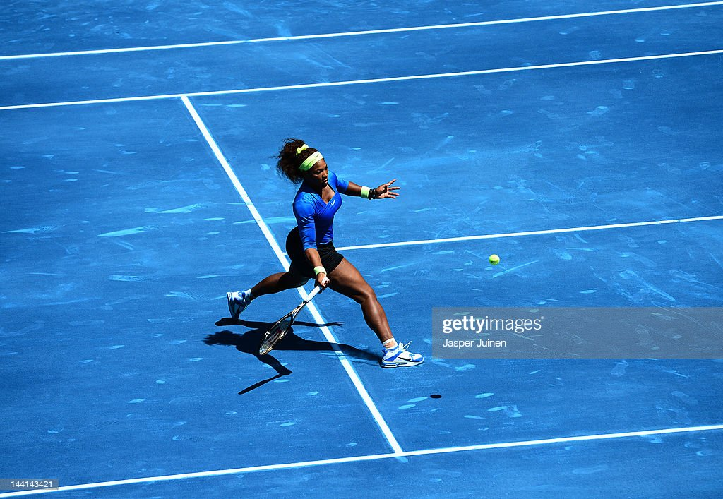 Serena Williams of the USA slides to play a backhand to Caroline Wozniacki of Denmark during the Mutua Madrilena Madrid Open tennis tournament at the Caja Magica on May 10, 2012 in Madrid, Spain.