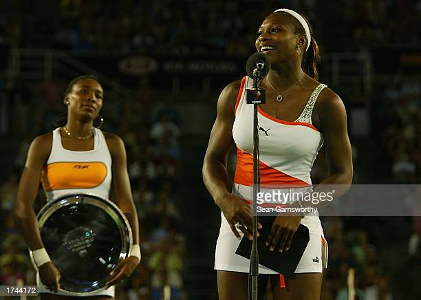 Serena Williams of the USA speaks to the crowd as runner up Venus Williams of the USA looks on after the Women's SinglesfFinal during the Australian...