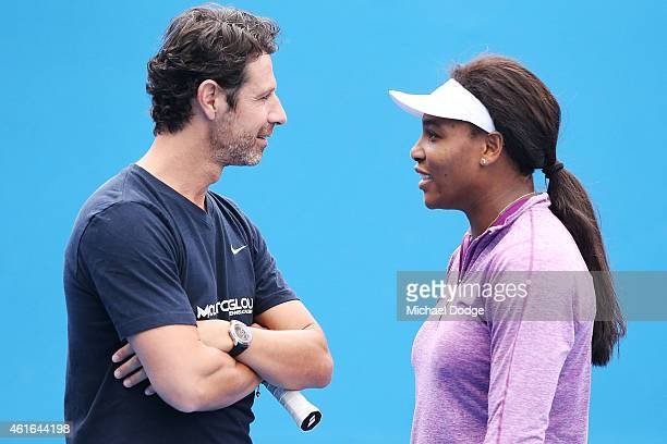 Serena Williams of the USA talks to her coach Patrick Mouratoglou during a practice session ahead of the 2015 Australian Open at Melbourne Park on...