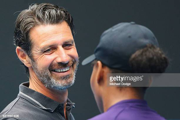 Serena Williams of the USA talks with her coach Patrick Mouratoglou during a practice session ahead of the 2017 Australian Open at Melbourne Park on...