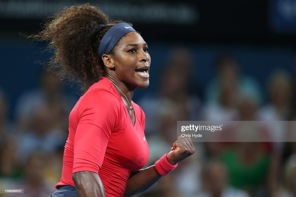 Serena Williams of United States celebrates after winning the first set against Sloane Stephens of United States on day five of the Brisbane International at Pat Rafter Arena on January 3, 2013 in Brisbane, Australia.