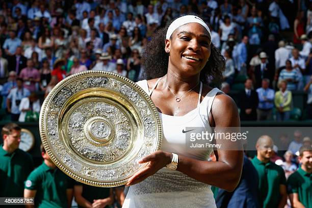 Serena Williams of United States celebrates with the trophy after winning the Final of the Ladies Singles against Garbine Muguruza of Spain during...
