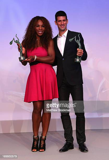 Serena Williams of United States of America and Novak Djokovic of Serbia pose with their Singles World Champion Awards during the ITF World Champions...