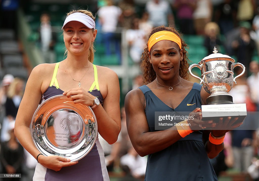 <a gi-track='captionPersonalityLinkClicked' href=/galleries/search?phrase=Serena+Williams&family=editorial&specificpeople=171101 ng-click='$event.stopPropagation()'>Serena Williams</a> of United States of America holds the Coupe Suzanne Lenglen next to <a gi-track='captionPersonalityLinkClicked' href=/galleries/search?phrase=Maria+Sharapova&family=editorial&specificpeople=157600 ng-click='$event.stopPropagation()'>Maria Sharapova</a> of Russia after victory in the Women's Singles Final match during day fourteen of French Open at Roland Garros on June 8, 2013 in Paris, France.