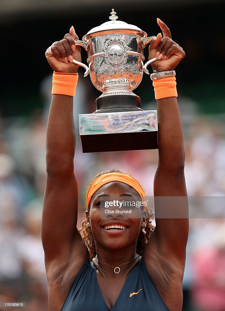 Serena Williams of United States of America lifts the Coupe Suzanne Lenglen after victory in the Women's Singles Final match against Maria Sharapova of Russia during day fourteen of French Open at Roland Garros on June 8, 2013 in Paris, France.