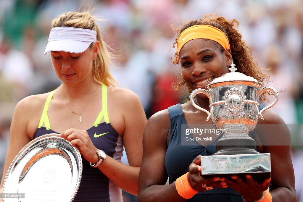 <a gi-track='captionPersonalityLinkClicked' href=/galleries/search?phrase=Serena+Williams+-+Tennis+Player&family=editorial&specificpeople=171101 ng-click='$event.stopPropagation()'>Serena Williams</a> of United States of America lifts the Coupe Suzanne Lenglen next to <a gi-track='captionPersonalityLinkClicked' href=/galleries/search?phrase=Maria+Sharapova&family=editorial&specificpeople=157600 ng-click='$event.stopPropagation()'>Maria Sharapova</a> of Russia after victory in the Women's Singles Final match during day fourteen of French Open at Roland Garros on June 8, 2013 in Paris, France.
