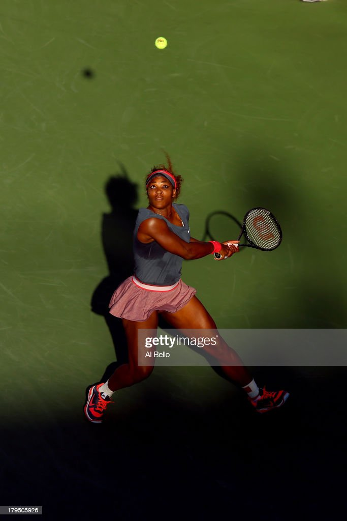 <a gi-track='captionPersonalityLinkClicked' href=/galleries/search?phrase=Serena+Williams+-+Tennis+Player&family=editorial&specificpeople=171101 ng-click='$event.stopPropagation()'>Serena Williams</a> of United States of America plays a backhand next to her partner Venus Williams of the United States of America in action during their women's doubles third round match against Anastasia Pavlyuchenkova of Russia and Lucie Safarova of Czech Republic on Day Ten of the 2013 US Open at USTA Billie Jean King National Tennis Center on September 4, 2013 in the Flushing neighborhood of the Queens borough of New York City.