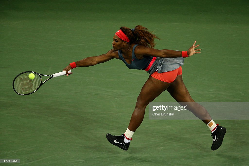 Serena Williams of United States of America plays a forehand during her women's singles quarter-final match against Carla Suarez Navarro of Spain on Day Nine of the 2013 US Open at USTA Billie Jean King National Tennis Center on September 3, 2013 in the Flushing neighborhood of the Queens borough of New York City.