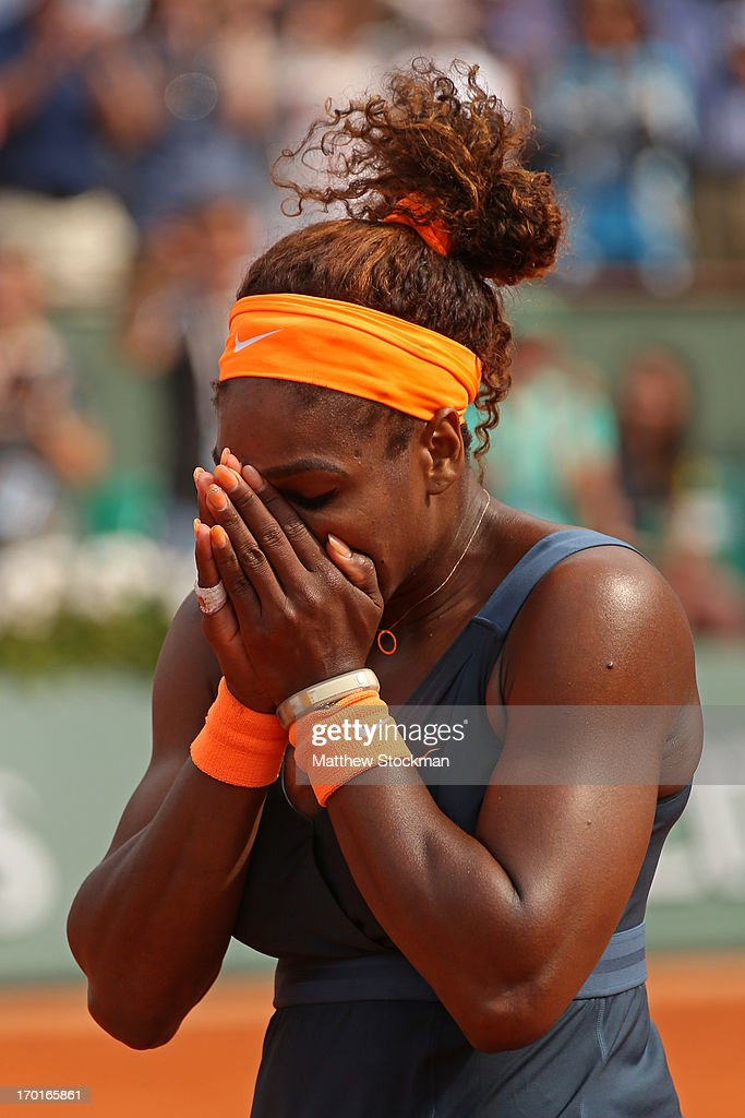 Serena Williams of United States of America reacts after match point in her Women's Singles Final match against Maria Sharapova of Russia during day fourteen of French Open at Roland Garros on June 8, 2013 in Paris, France.