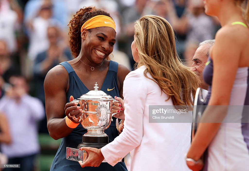 <a gi-track='captionPersonalityLinkClicked' href=/galleries/search?phrase=Serena+Williams&family=editorial&specificpeople=171101 ng-click='$event.stopPropagation()'>Serena Williams</a> of United States of America receives the Coupe Suzanne Lenglen from Arantxa Sanchez Vicario after victory in the Women's Singles Final match against Maria Sharapova of Russia during day fourteen of French Open at Roland Garros on June 8, 2013 in Paris, France.