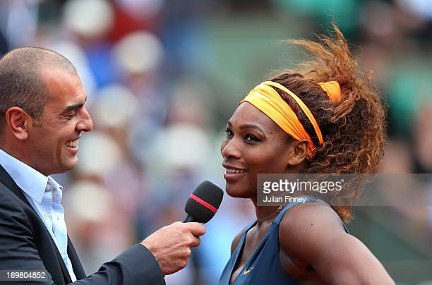 Serena Williams of United States of America speaks with former player Cedric Pioline after the Women's Singles match against Roberta Vinci of Italy...