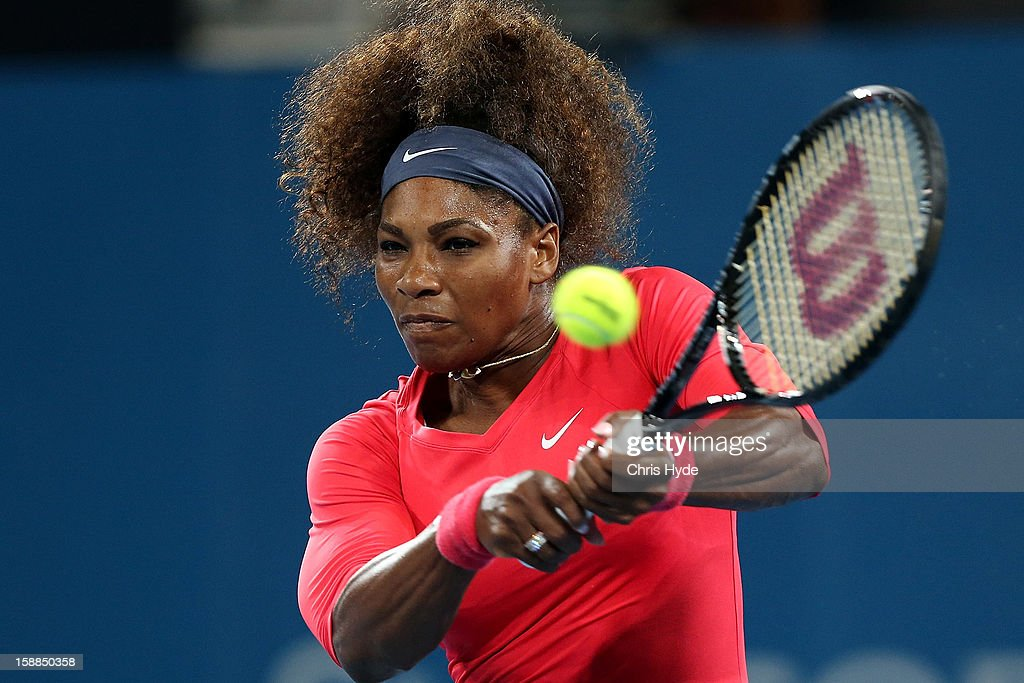 Serena Williams of United States plays a backhand during her match against Alize Cornet of France on day three of the Brisbane International at Pat Rafter Arena on January 1, 2013 in Brisbane, Australia.