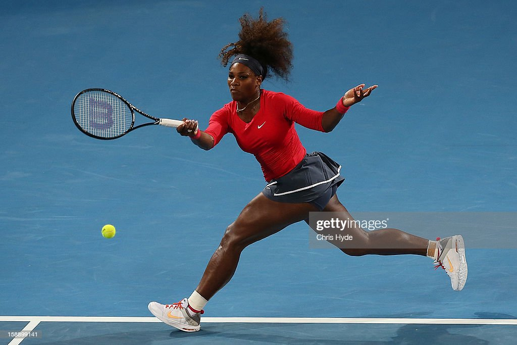 Serena Williams of United States plays a forehand during her match against Sloane Stephens of United States on day five of the Brisbane International at Pat Rafter Arena on January 3, 2013 in Brisbane, Australia.