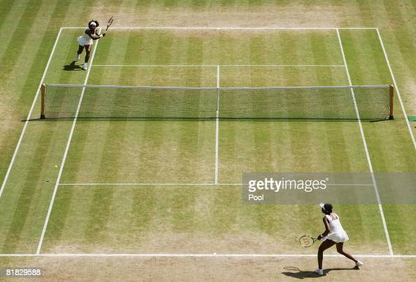 Serena Williams of United States plays a shot down the line during the women's singles Final match against Venus Williams of United States on day...