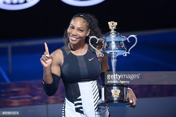 Serena Williams of United States poses with the championship trophy after winning the Australian Open women's singles final match against his sister...