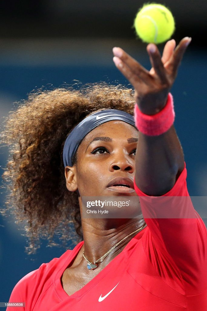 Serena Williams of United States serves during her match against Alize Cornet of France on day three of the Brisbane International at Pat Rafter Arena on January 1, 2013 in Brisbane, Australia.